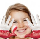 Fan happy girl with painted hands and polish flag